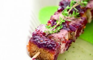 Tofu Skewer with Red Wine on Peas and Potatoes Velvety